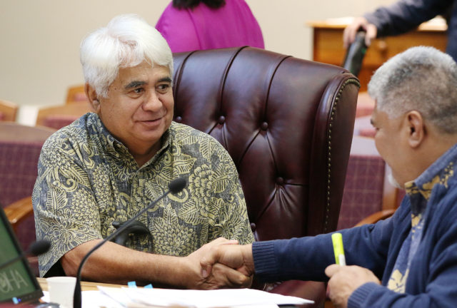 OHA Trustee Robert Stender greets OHA CEO Kamanapono Crabbe before 10am meeting. 4 jan 2017