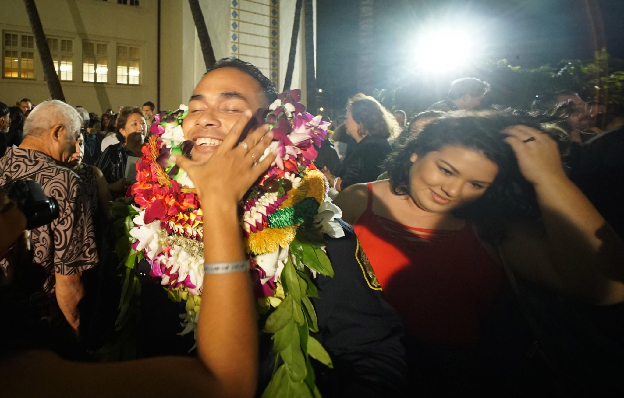 <p>Graduate Adam Ruiz got some help with his leis after becoming one of Honolulu's newest police officers.</p>
