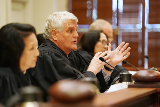 Chief Justice Mark Recktenwald gestures while questioning City attorney Duane Pang in Civil Beat case. 1 june 2017