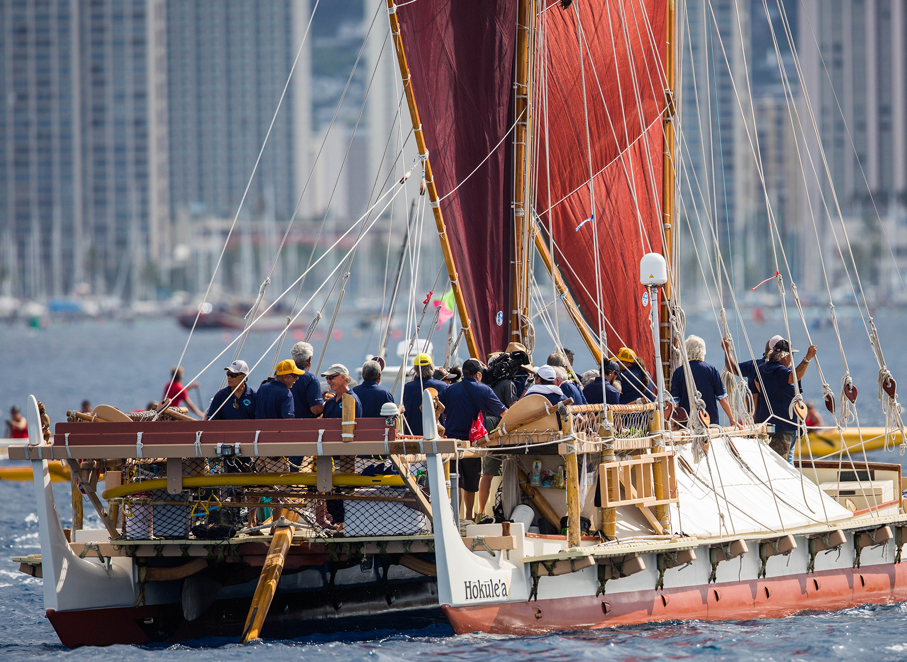 <p>Crewmembers are all smiles on their approach to Honolulu. Over the course of the journey, more than 250 volunteer sailors for the Polynesian Voyaging Society took turns aboard the vessel. / Anthony Quintano</p>