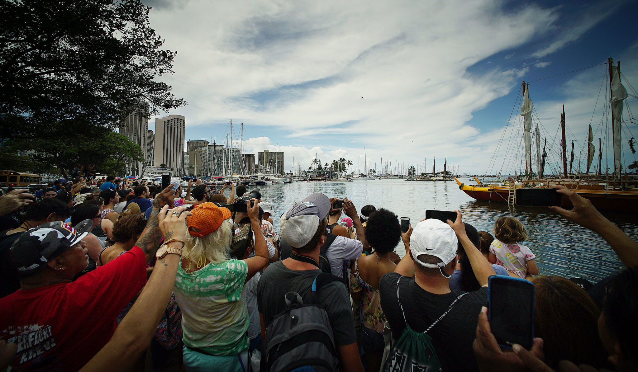 <p>Cellphones rise to record the arrival of Hokulea. The ceremony that followed included speeches by Gov. David Ige, Mayor Kirk Caldwell and Polynesian Voyaging Society president Nainoa Thompson. / Cory Lum</p>