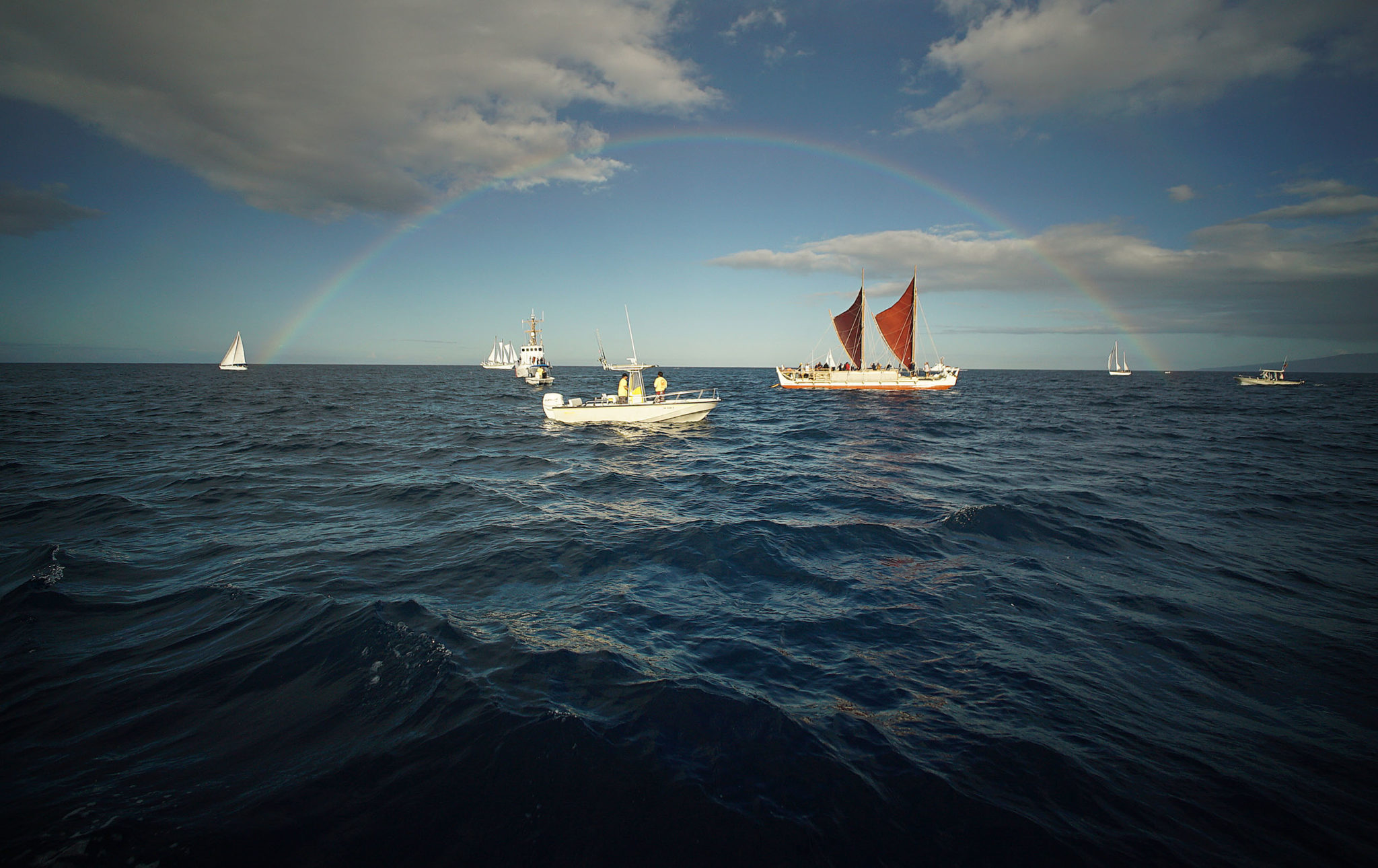 <p>Hokulea offshore Waikiki on her way to the Hokulea Homecoming Ceremony and Celebration. Cory Lum/Civil Beat</p>