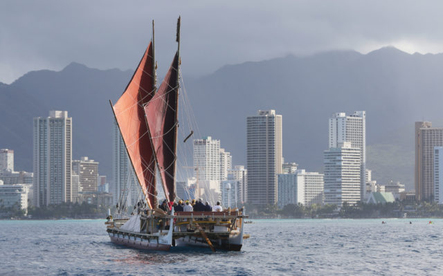 Hokulea sails offshore Waikiki on her way to Magic Island.
