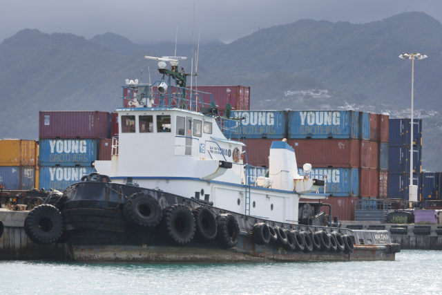 Young Brothers Tugboat Mikiona sits dockside in Honolulu Harbor.