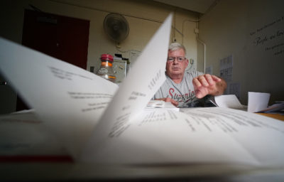 Daniel Junker shares documents, tons of paperwork inundated from his workers comp claim.
