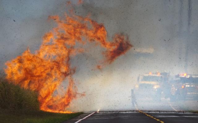 Honolulu Fire Department firefighters battle brush fire along Kunia Road today.