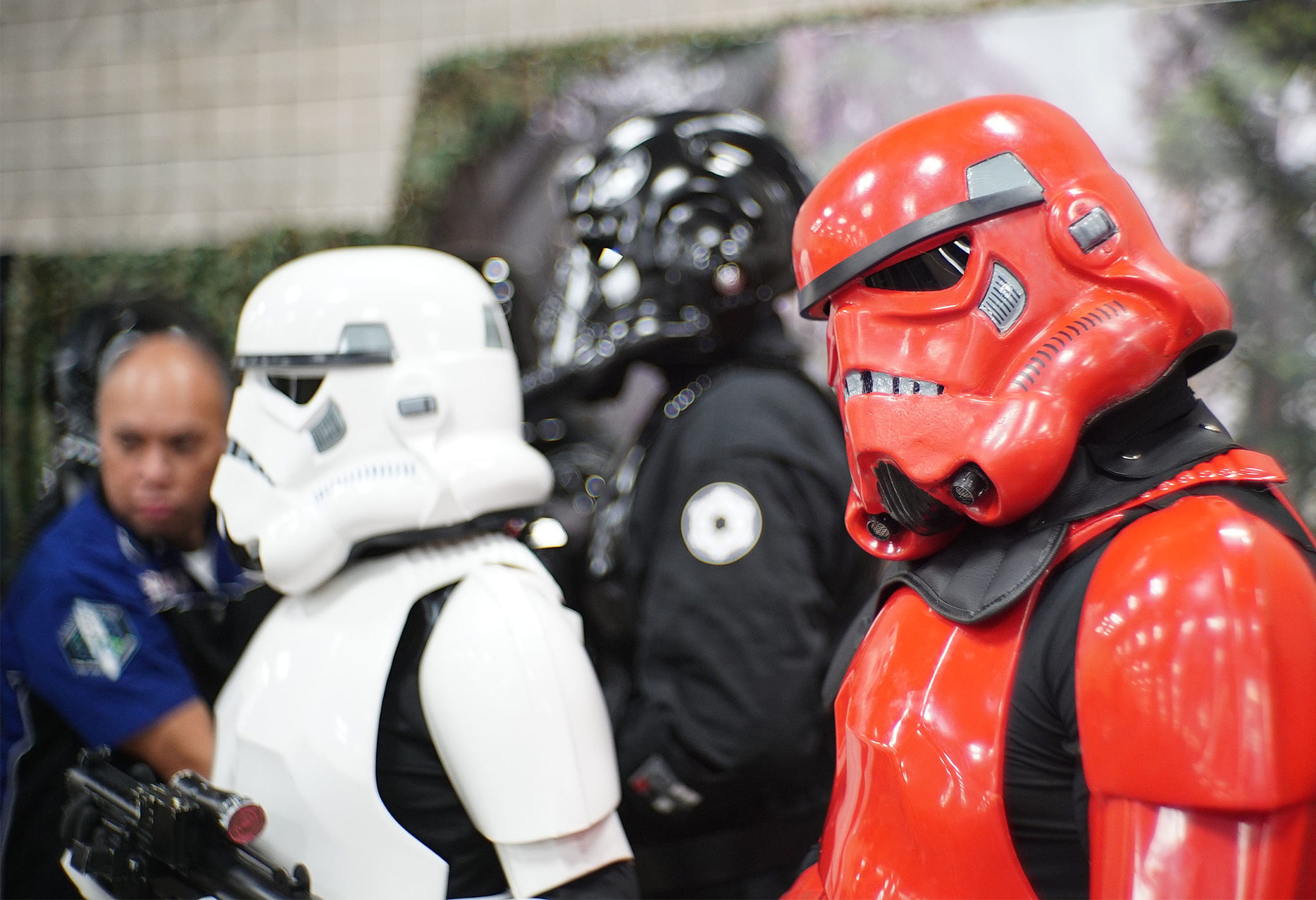 """<p>""""Star Wars"""" stormtroopers pose for photographs with attendees at the third annual comics convention.</p>"""