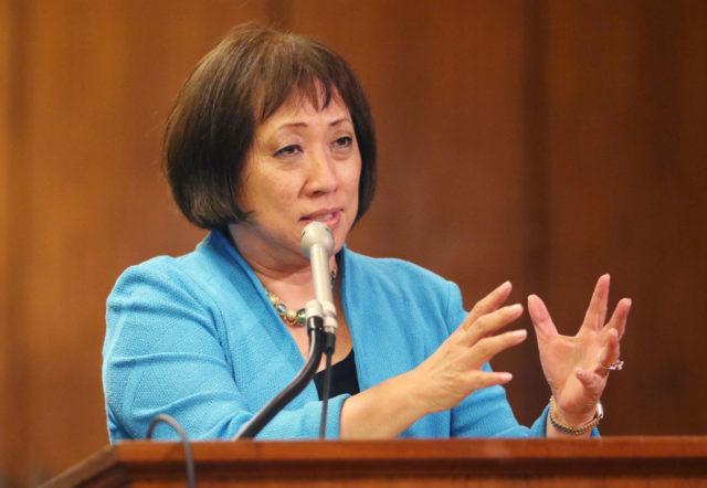 Congresswoman Colleen Hanabusa answers questions from senators in rail meeting.