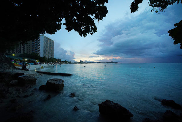 Rain clouds sit on the horizon offshore Guam's Tumon Bay, one of Guam's major tourist centers on the island.