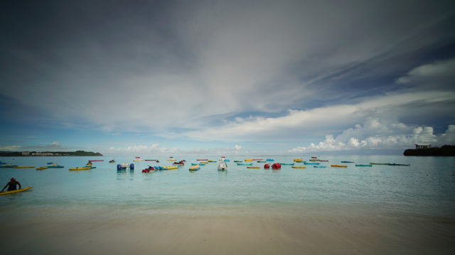 Rental beach gear sits on Tumon Bay in the morning.