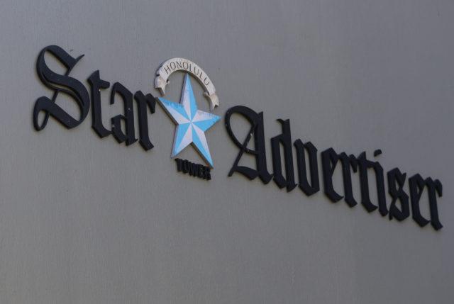 Honolulu Star Advertiser sign on the Restaurant Row building.