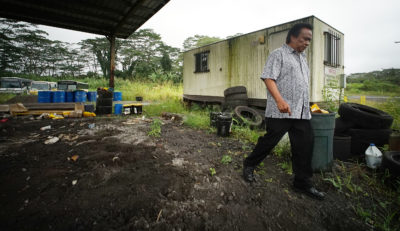 Michael Makekau walks near the old portable building he was sickened by mold from an airconditioner at the Hilo landfill. Portable building can be seen at right of photograph.