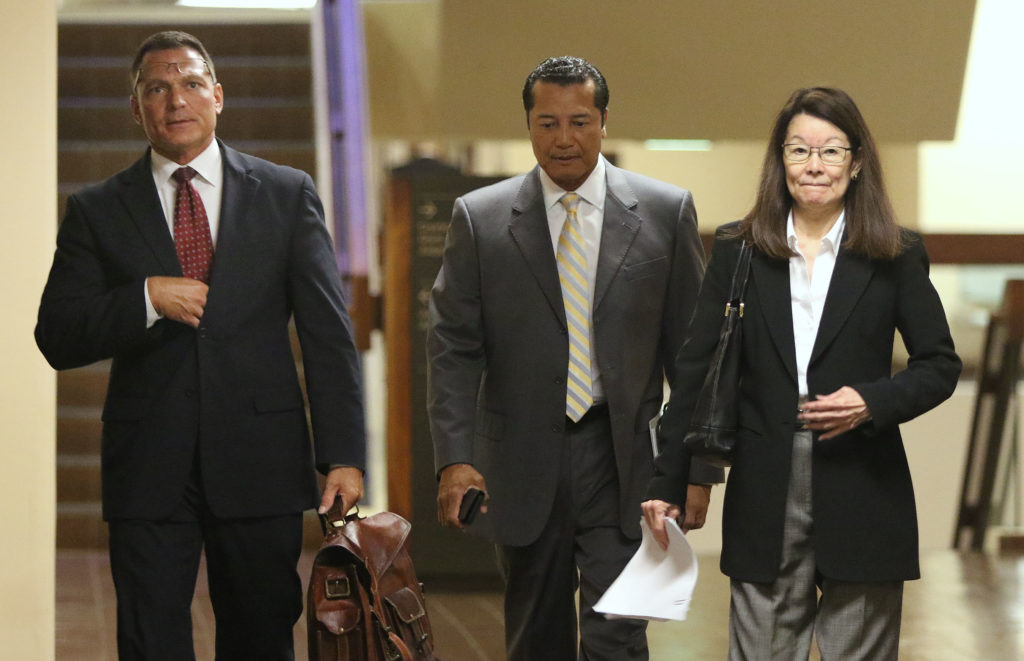 Deputy Prosecutor Duane Kokesch, center Attorney William Harrison and right, Deputy Atty Jan Futa walk to Judge Trader's court room for Grube's hearing.
