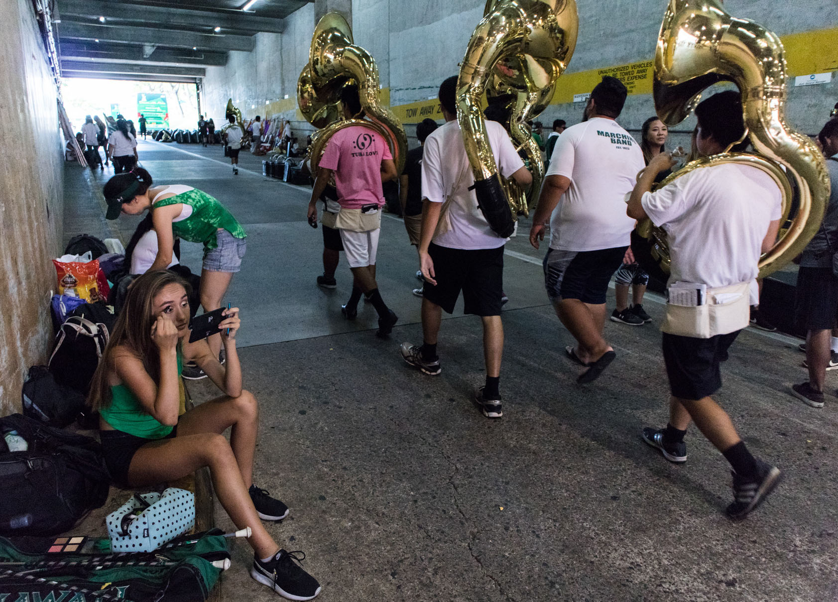 "<p>But hours before the game comes practice with the marching band. Dooms camps beside the stadium's north exit to prepare. ""My makeup, rhinestones and attire transform me into the twirler.""</p>"