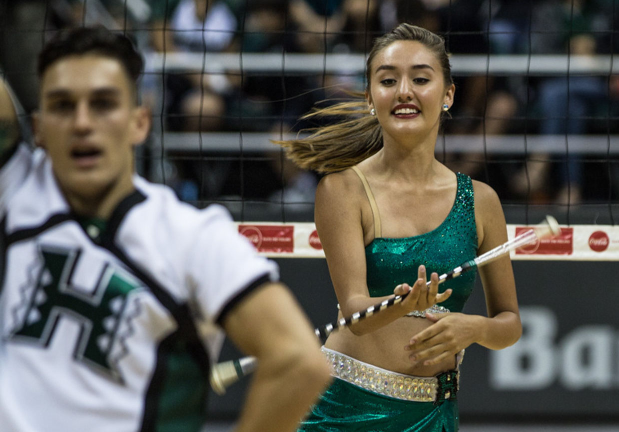 "<p>On the court with UH cheerleaders, Dooms gets in some twirling during a lull in the action at the volleyball game. The biochemistry major says of being the school's feature twirler: ""It's something that I love. It's like an alternative side of me.""</p>"