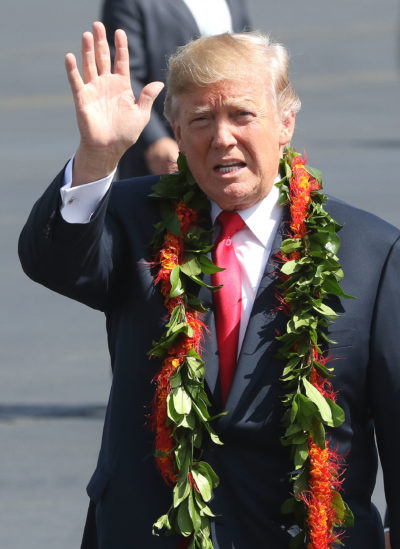 President Donald J Trump waves to media after arrival to Joint Base Hickam Pearl Harbor.