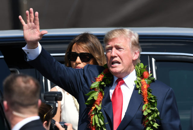 President Trump waves to crowd before jumping into his vehicle after landing at Joint Base Hickam Pearl Harbor.