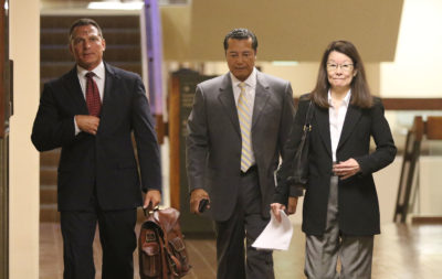 Right, Deputy Prosecutor Jan Futa with center, Attorney William Harrison walk to Judge Trader's courtroom for Grube case.
