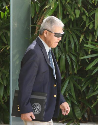 Prosecutor Keith Kaneshiro leaves District Court.