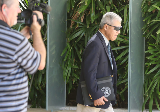 Prosecutor Keith Kaneshiro leaves District Court.