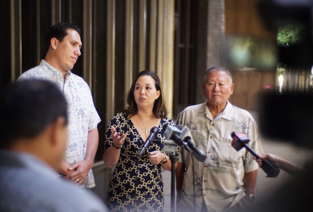 Senator Jill Tokuda flanked by left, Rep Jarrett Keohokalole and Rep Ken Ito in the Capitol Rotunda to address recent concerns about the recent Saito escape from the Kaneohe Hospital.