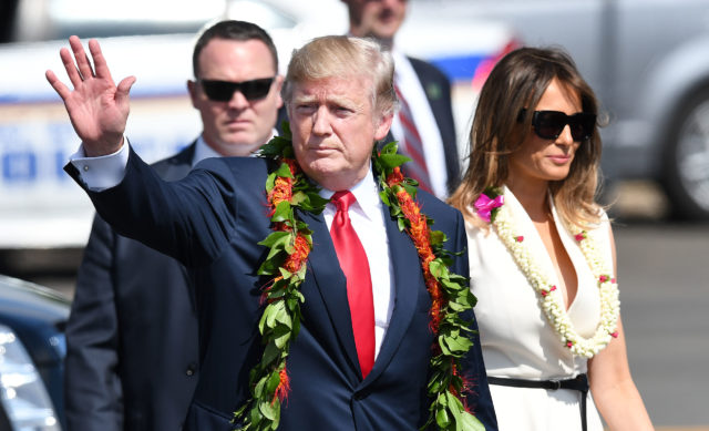 President Donald Trump walks with First Lady Melania Trump at Joint Base Hickam Pearl Harbor.