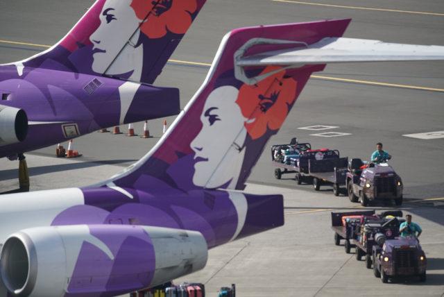Hawaiian Airlines jet at Daniel Inouye International Airport. Honolulu, Hawaii.