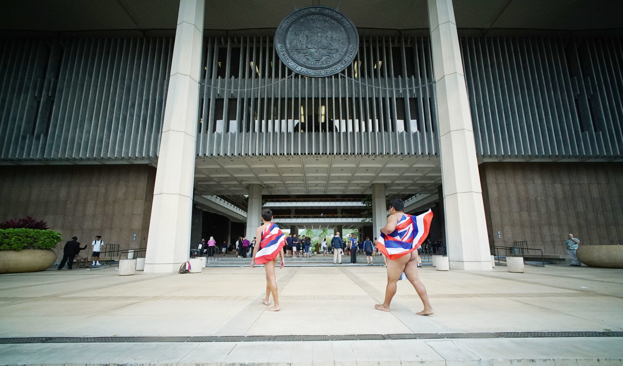 <p>Wrapped in Native garb and Hawaiian flags, Kamehameha students La'akea Awong, 14, and Jonah Kahuli-Apo, 15, entered the Capitol before the session begin.</p>