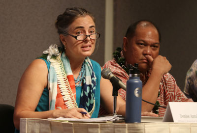 Moderator Hawaii Energy Forum keynote panel members left, Denise Antolini and right, Leo Asuncion at the Capitol.