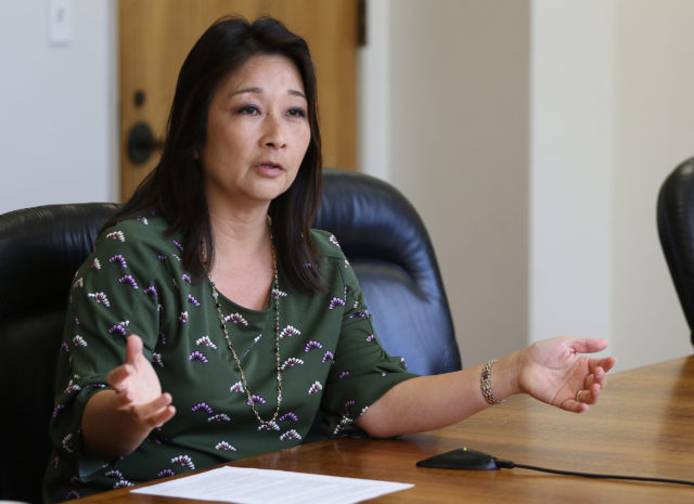 Rep Chair Sylvia Luke answers questions during Civil Beat Editorial meeting held at Speaker Saiki's office.