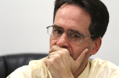 Sen Karl Rhoads listens to HTA Director Szigeti speak during joint senate hearings.