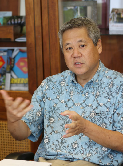 Speaker Scott Saiki gestures while speaking at Civil Beat's editorial meeting held in Speaker's office.