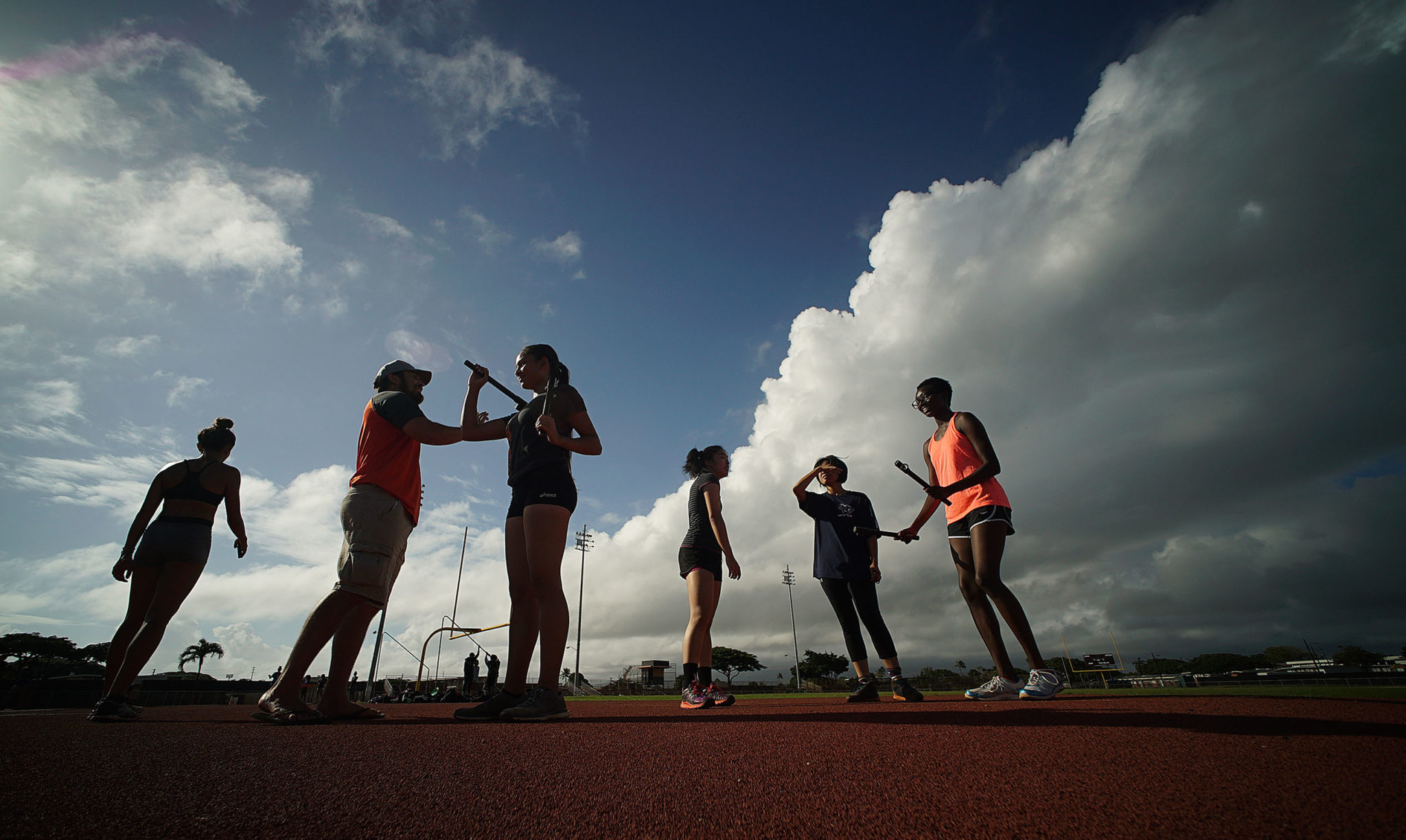 Campbell HS girls track members practice on the field.