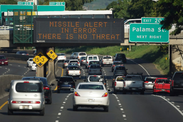 Electronic sign reads 'MISSILE ALERT IN ERROR THERE IS NO THREAT' on January 13, 2018
