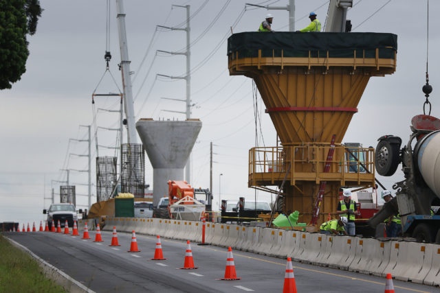 HART Rail contractors from STG stand on column support or 'piers' along Kamehameha Highway.