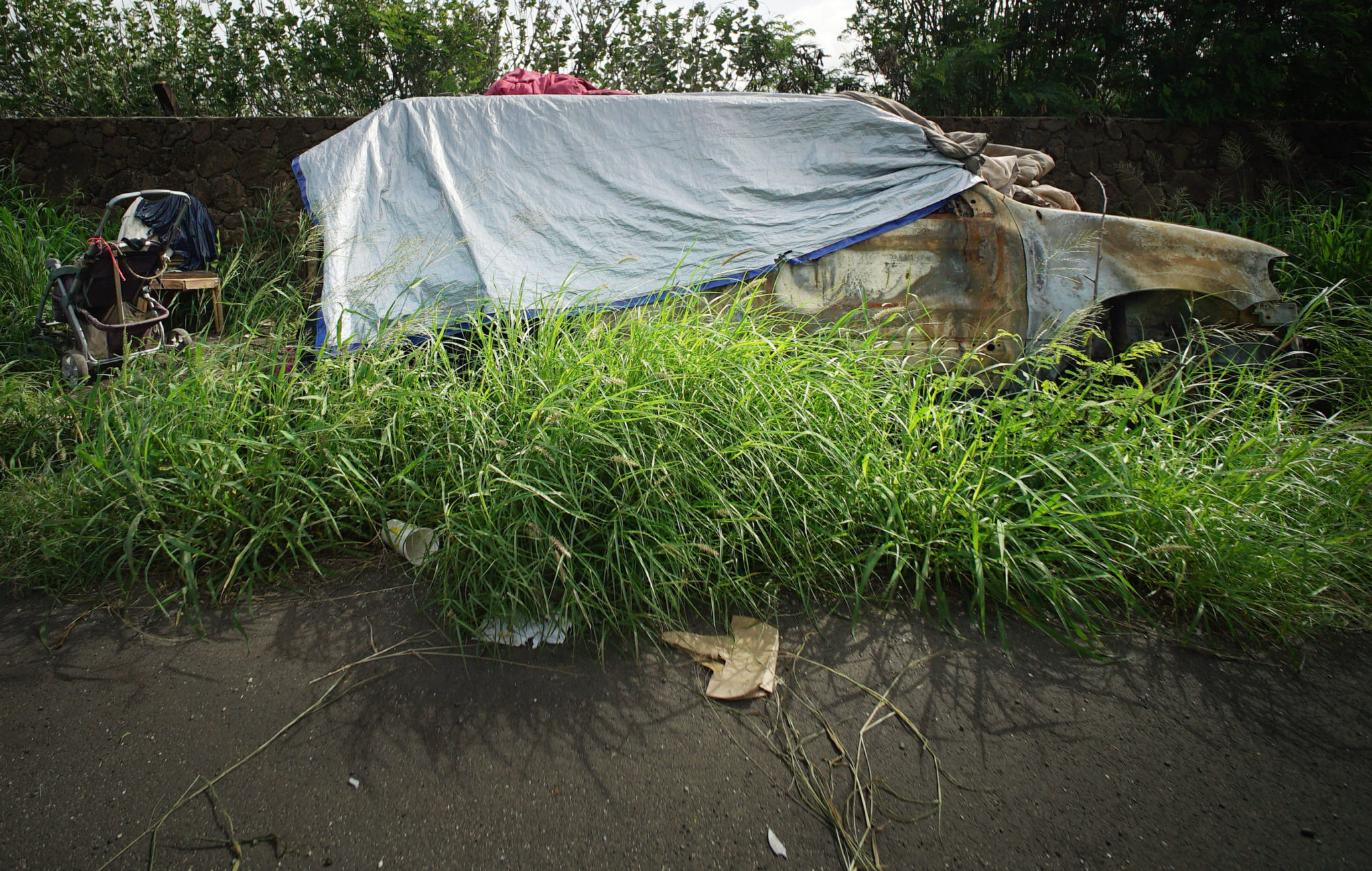 <p>With a tarp for a roof, this vehicle alongside Kaukamana Road in Waianae may be someone's temporary shelter.</p>