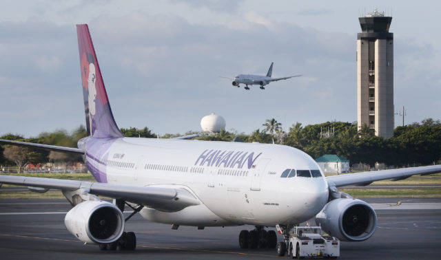 Hawaiian Airlines Airbus A300-200 is moved to takeoff from Daniel K. Inouye International Airport.