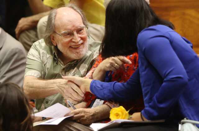 Gov Neil Abercrombie before death with aid bill in the House at the Capitol.