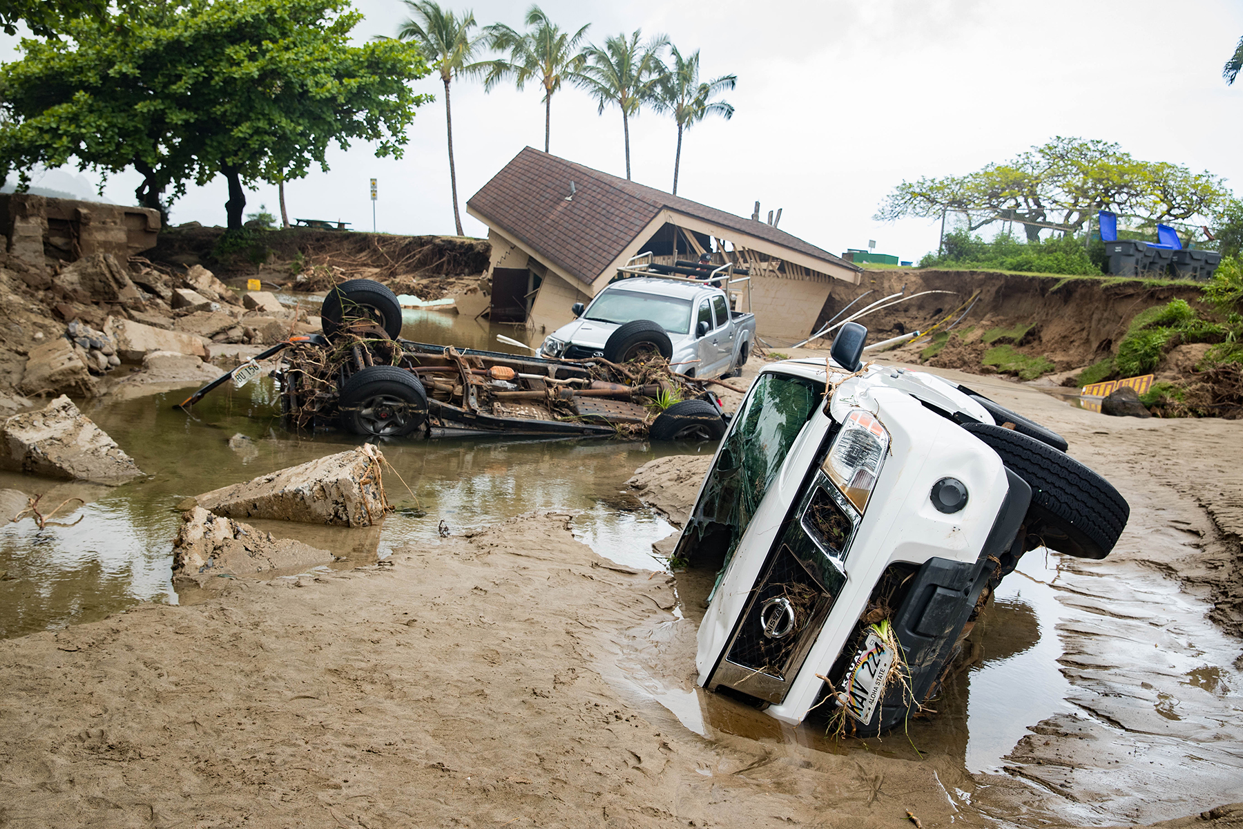 <p><strong>LONGTERM RAMIFICATIONS:</strong> Flash floods toppled vehicles and public restrooms near the entrance to Hanalei Pier. At year's end, there is still limited access to some portions of Kauai's North Shore. / Anthony Quintano</p>
