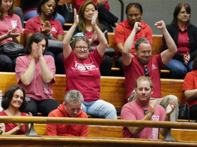 HSTA staff and teachers jubilate after the Senate passed a key vote today to ask voters to decide this fall whether the statehould be empowered to impose a surcharge on residential investment properties to help fund public education. Constitutional Amendment.