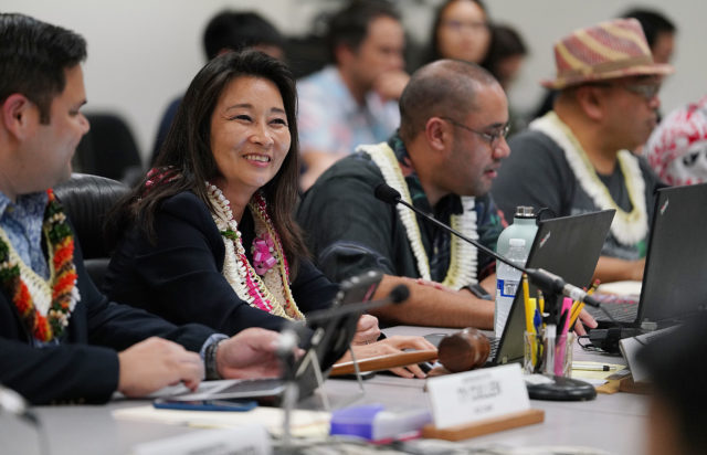 Joint Finance WAM budget Chair Sylvia Luke during light moment with Chair Donovan Delacruz.