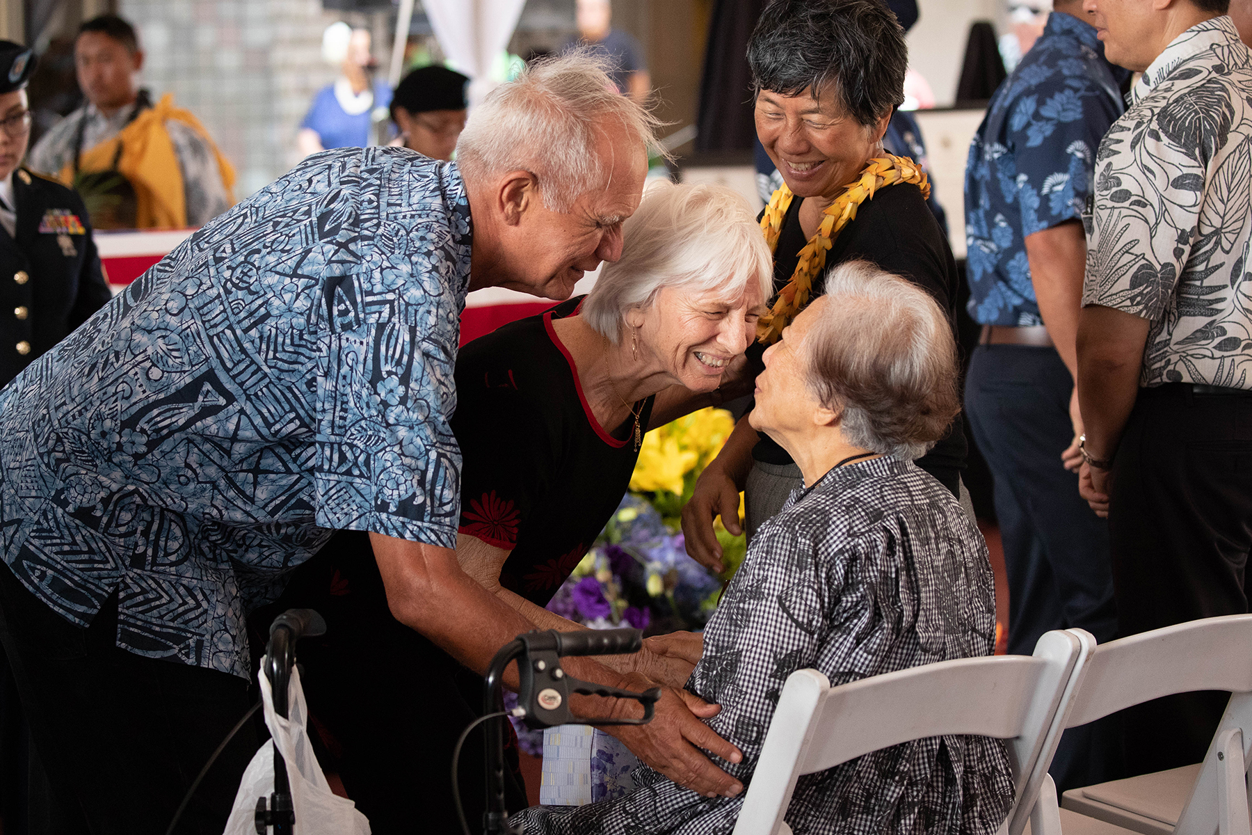<p>Hawaii State Sen. Mike Gabbard and wife Carol pay their respects to the late senator's wife, Millie Akaka, while the Akakas' daughter, Millannie Akaka Mattson, looks on.</p>