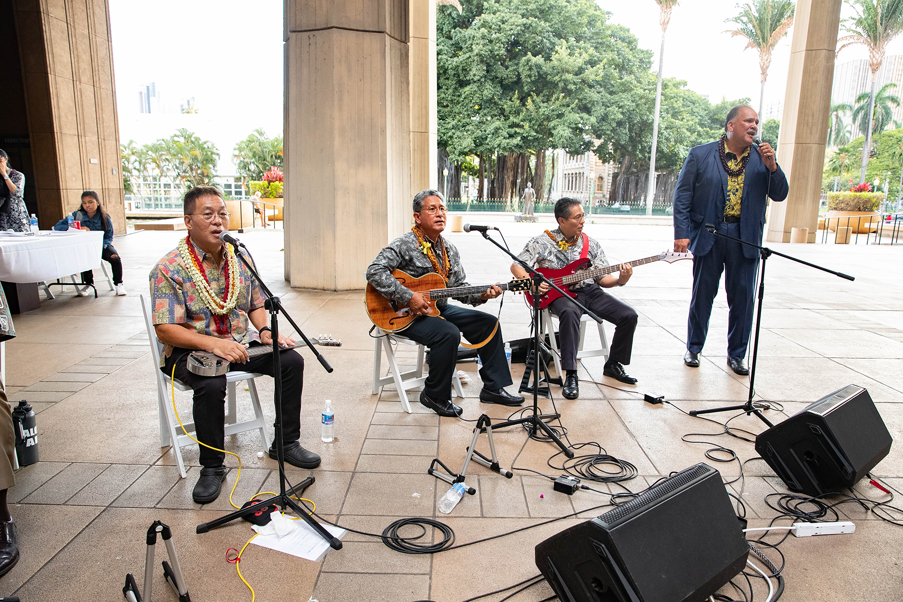 <p>From left: Three of the senator's sons — Alan Akaka, Danny Akaka Jr. and Dr. Gerard Akaka — perform with Kauai Mayor Bernard Carvalho Jr. at the Capitol Rotunda, part of Friday evening's service.</p>