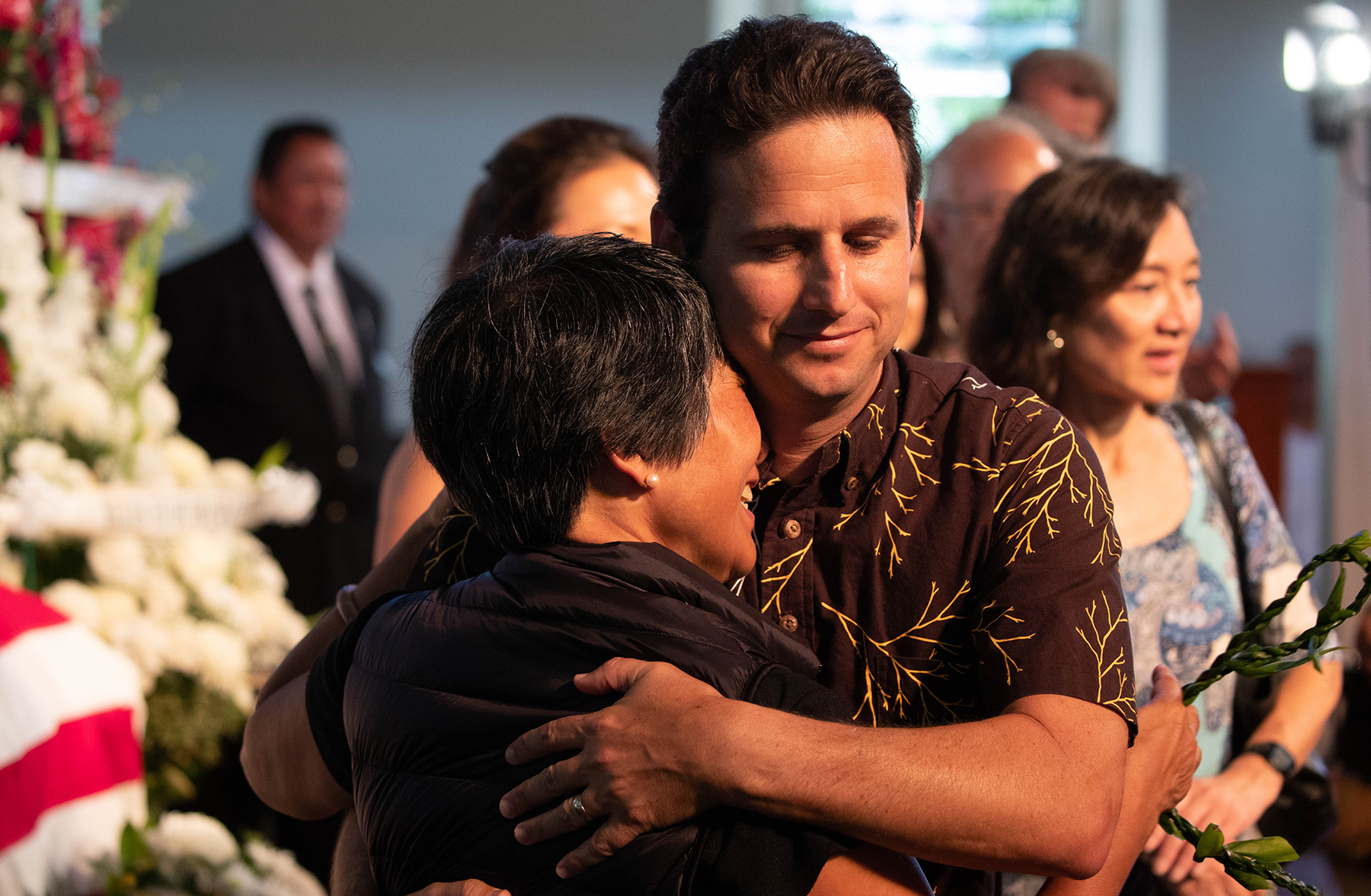 <p>U.S. Sen. Brian Schatz hugs the late senator's daughter Millannie Akaka Mattson before the Friday service begins. U.S. Sen. Mazie Hirono and U.S. Reps. Colleen Hanabusa and Tulsi Gabbard also paid their respects.</p>