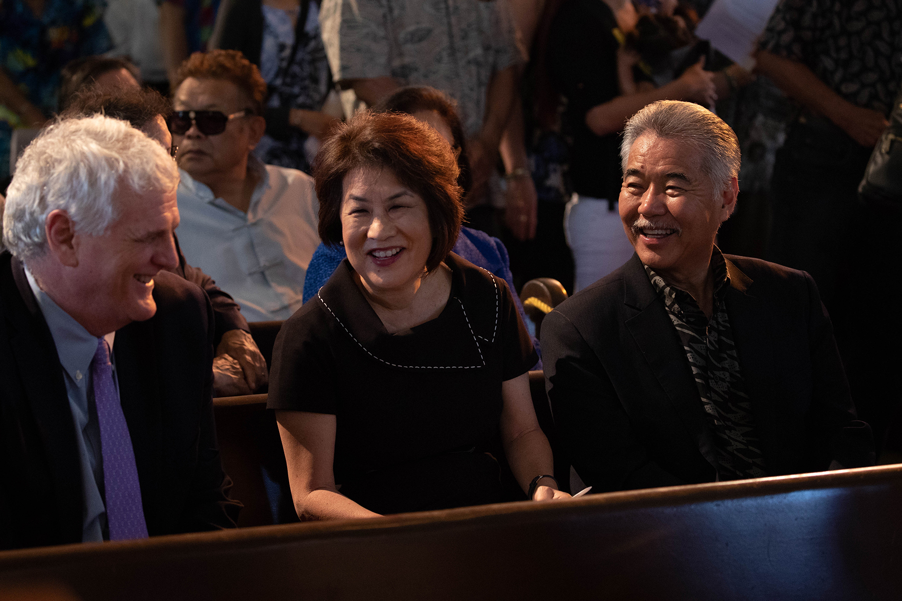 <p>Gov. David Ige and wife, Dawn Amano-Ige, share a lighter moment with Hawaii Chief Justice Mark Recktenwald, at left, before the memorial service begins.</p>