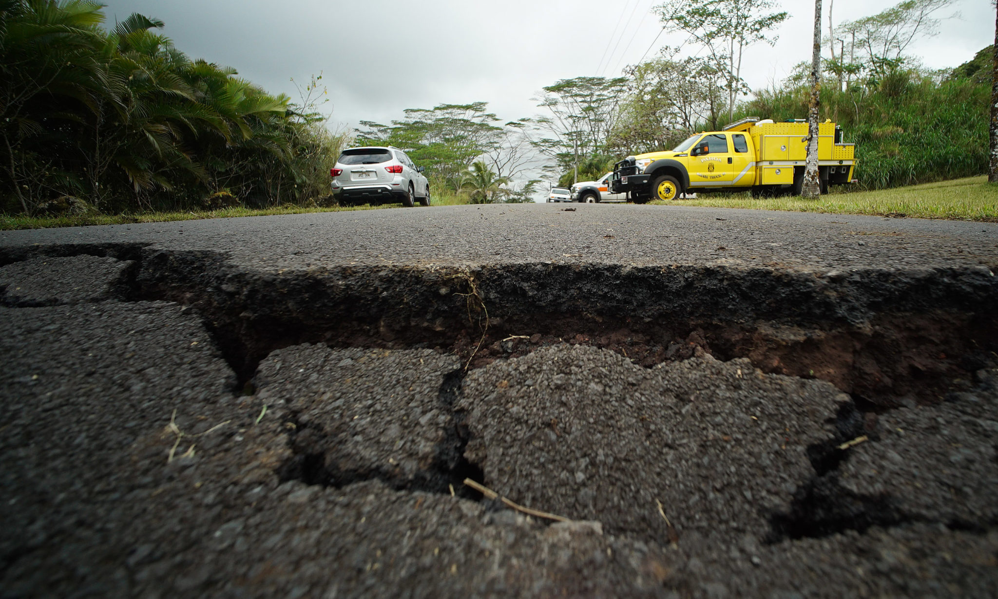 <p>Cracked roads on Kahukai Street in Leilani Estates, where alerts went off on Tuesday notifying residents of an emergency evacuation due to poisonous gases.</p>