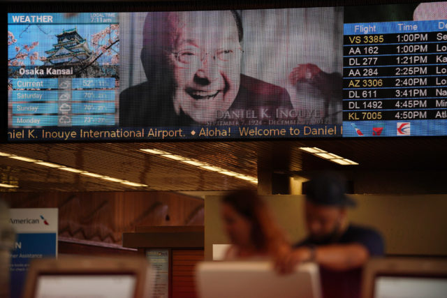 Video runs on a large screen monitor at Daniel Inouye International Airport.