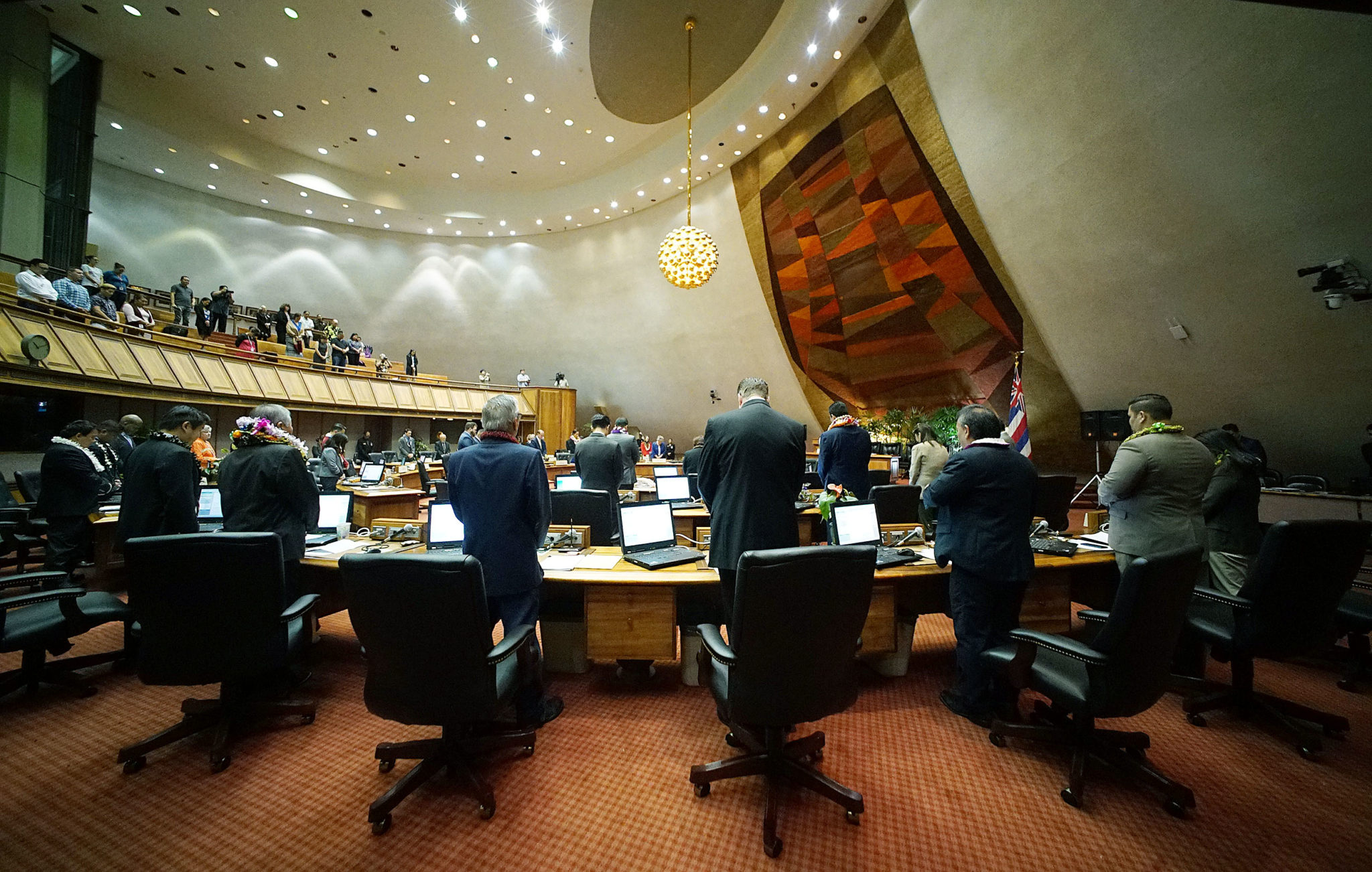 <p>On the final day of the 2018 legislative session, House members stand during a prayer by Rep. Isaac Choy, who is leaving the House after serving since 2009.</p>