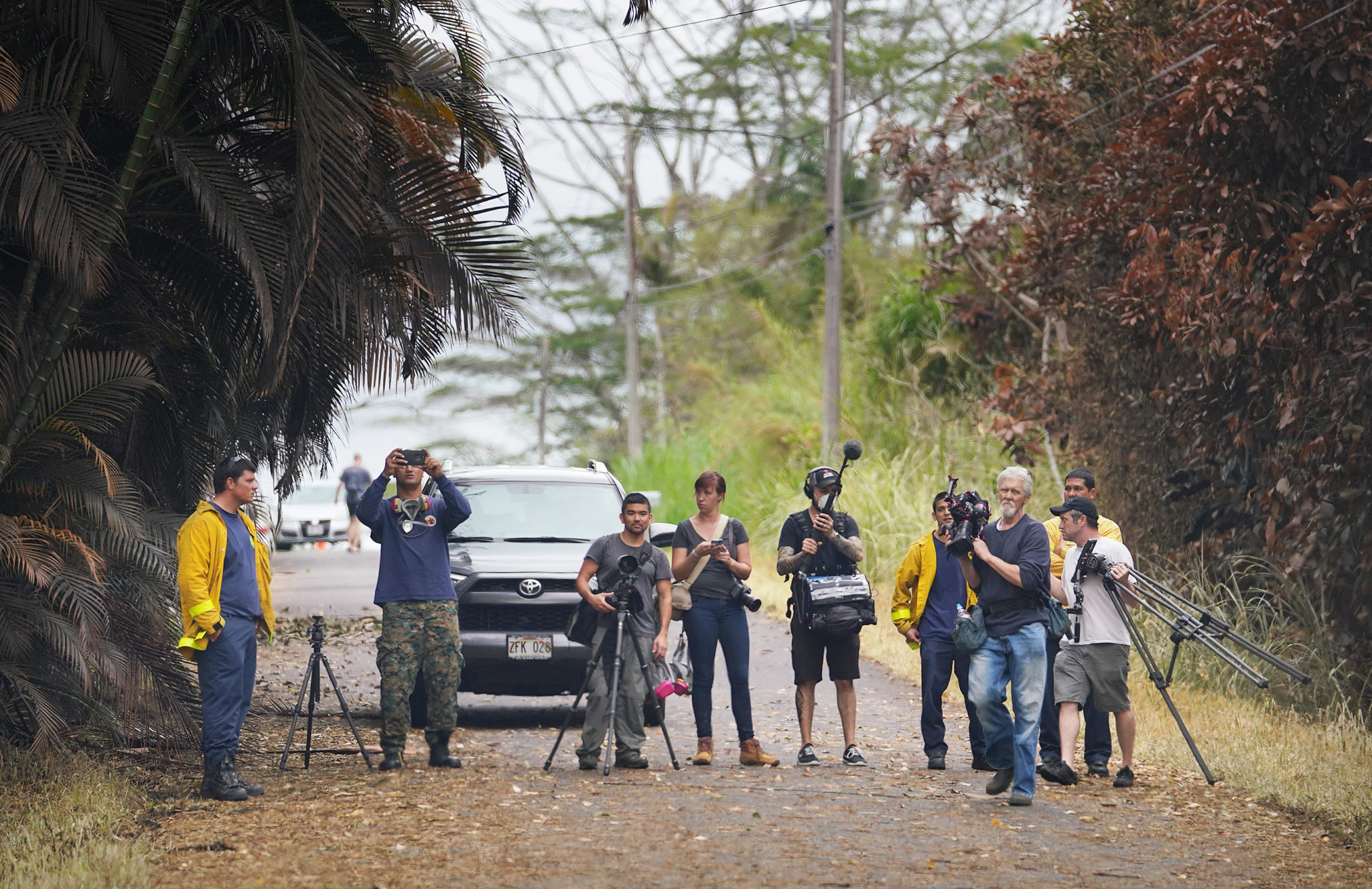 <p>Leilani Gardens resident Mick Kalber, a professional photographer and filmmaker, checks out a new outbreak along Kahukai Street along with members of the media.</p>