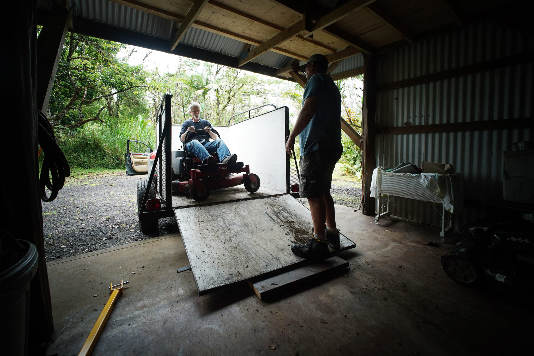 <p>Mick Kalber, a professional photographer and filmmaker who specializes in shooting volcanos, loads up his large mower, shredder and tools after the county allowed Leilani Estates residents to check on their homes. A short time later, the county issued an alert ordering emergency evacuation due to poisonous sulfur dioxide fumes.</p>